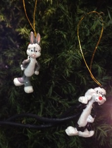 Two tiny tree ornaments showing Bugs & Sylvester on our tree in christmas hats