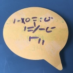 An orange word-bubble sticky note with purple marker writing on it meant to indicate a language with no consonants or vowels are being recognized by the listener